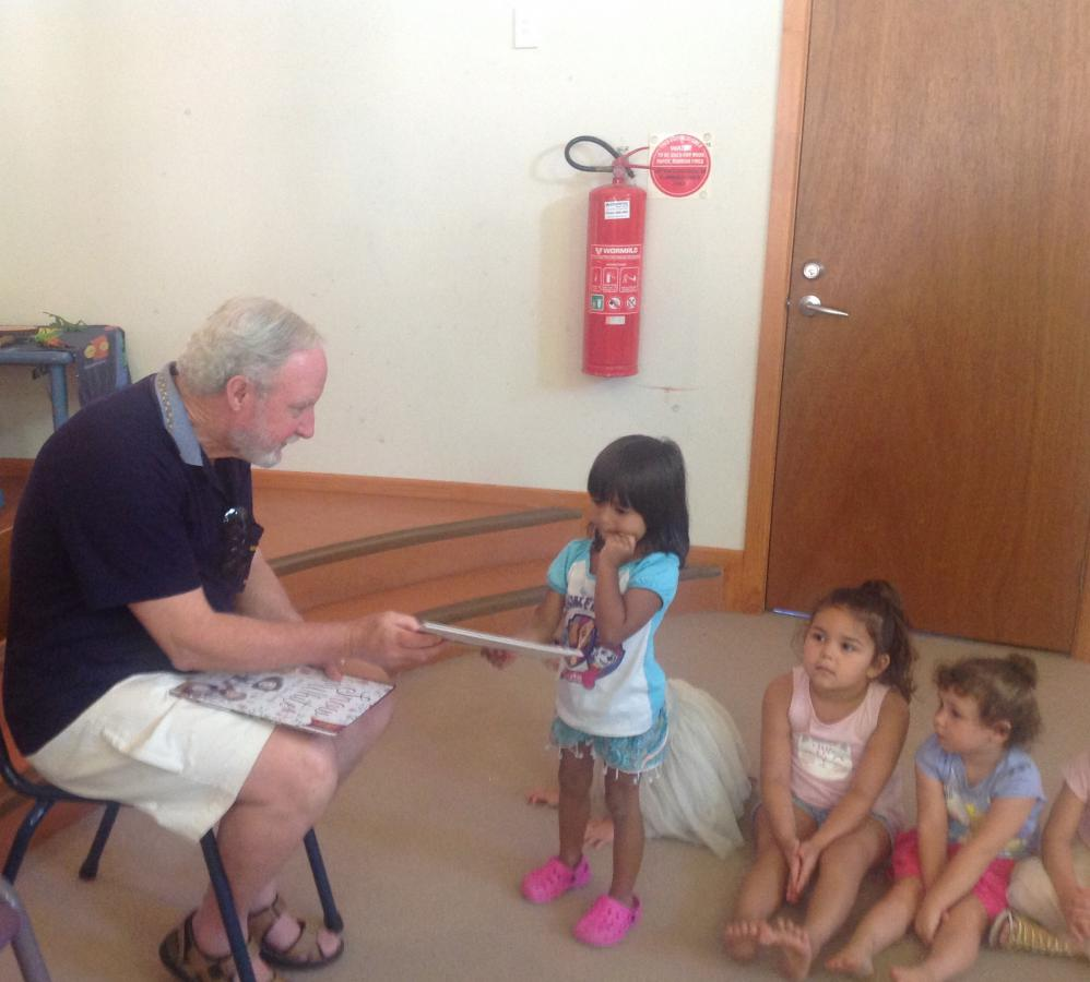 Rotarian Dr Paul Moran - Christmas Book Presentation to Kulai Preschool Students
